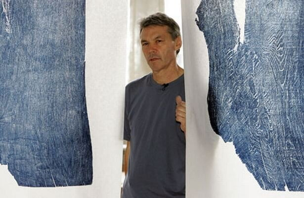 julian-meredith-with-details-of-the-prints-taken-from-the-woodblocks-which-hang-from-the-ceiling-489636494.jpg